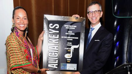 Alicia Keys receives the Songwriter Icon Award from NMPA's David Israelite