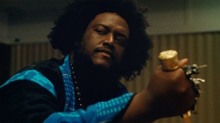 Watch: Kamasi Washington looks for action in surreal new video for 'Street Fighter Mas'