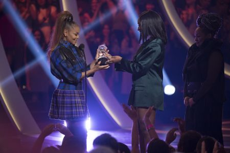 """Janet Jackson receives the first-ever """"Impact"""" Award on stage at the 2018 Radio Disney Music Awards."""