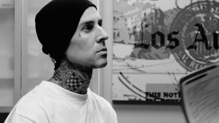 Travis Barker walks away unscathed from school bus crash