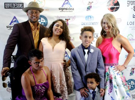 LOS ANGELES, CA: July 21, 2018 - Pooch Hall and wife Linda celebrate with their family at the 5th Annual Special Needs Family Prom, held at