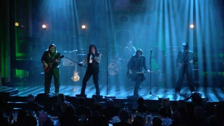 Alice Cooper perform on stage during their 2011 Rock and Roll Hall of Fame induction ceremony.