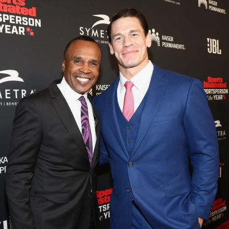 BEVERLY HILLS, CA - DECEMBER 11: Sugar Ray Leonard (L) and SI Muhammad Ali Legacy Award recipient John Cena attend Sports Illustrated 2018 S