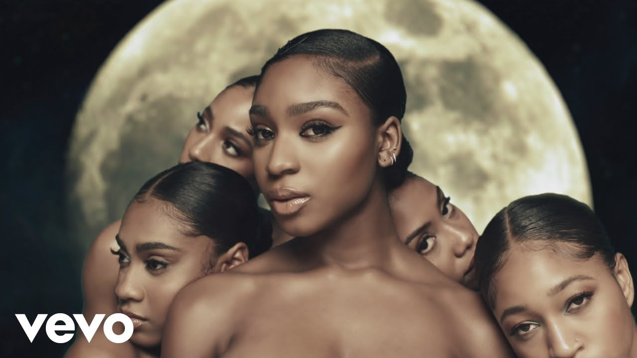 Normani gets cozy with 6lack in galactic 'Waves' music video