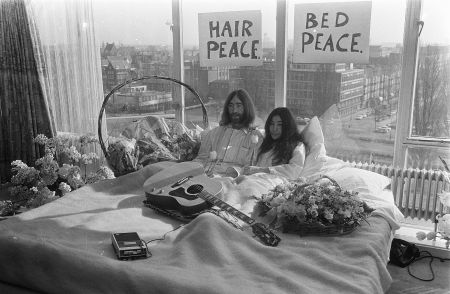 John Lennon & Yoko Ono stage a bed-in for peace in Amsterdam, March 1969.