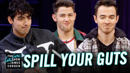 Watch: James Corden spurs sibling rivalry between Jonas Brothers in epic 'Spill Your Guts' game