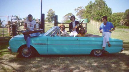 Interview: Parcels' Louie Swain shares tour stories and hints at unfolding album narrative