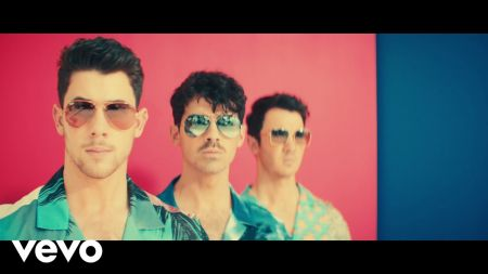 Watch: Jonas Brothers pay homage to the 80s in 'Cool' music video